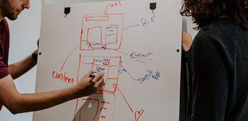 An SEO expert designs technical search engine optimization on  a whiteboard