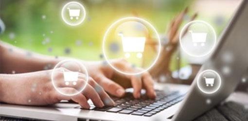 Solteq blog - verkkokauppa ikoneita kuplassa kannettavan tietokoneen näppäimistön päällä