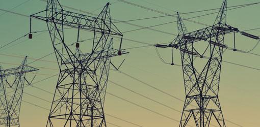 Powerlines over greenish sky
