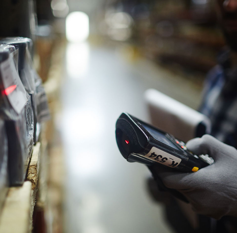 Order Engine - Barcode scanner reading product information in a warehouse